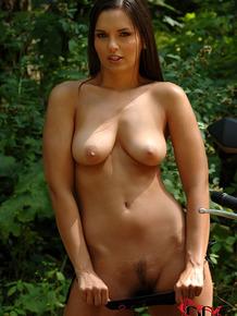 Beautiful solo girl Eve Angel hops off her bike to remove bikini in the woods