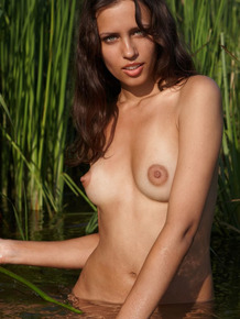 Nature loving Arina D plays naked in the water with her hard nipples bared