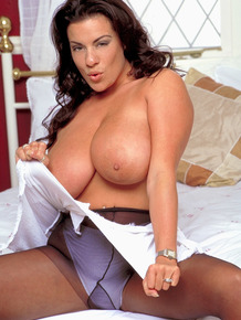 Solo girl Linsey Dawn McKenzie uncorks her knockers before ripping open hose