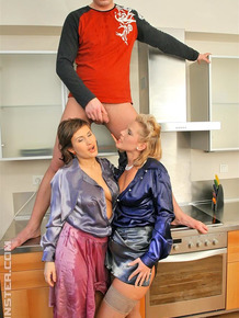 Fully dressed women surprise a younger boy with watersports action in kitchen