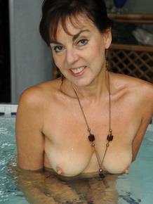 Mature exhibitionist Georgie revealing her hot body and relaxing at the spa