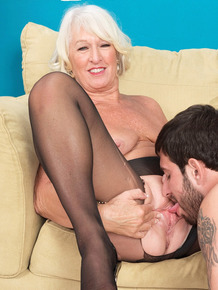 Mature blonde in nylon stockings Jeannie Lou fucks a young stud properly