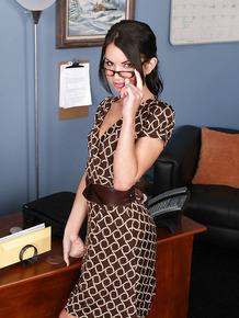 Nerdy office worker Micah Moore stripping naked in office wearing glasses
