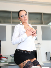 Busty secretary is all alone at the office masturbating with her sex toy