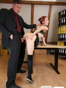 German redhead Jezzicat with tattoos and piercing fucked by boss in file room