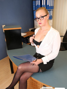 Seductive blondie with glasses teasing with her love holes on the office desk