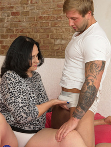 Old woman on the heavy side is stripped and jizzed on by her toy boy