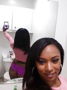 Curvy black chick Porsha Carrera taking selfies of her big black tits