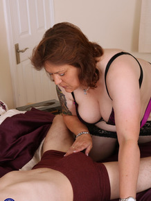 Fat British woman and her toy boy bang away after getting undressed