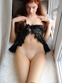 Petite redhead Indi looking very sexy in her exotic stockings