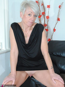 Sophisticated mature lady in black dress Shazzy B reveals sexy boobs & coochie