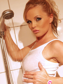 Hot MILF Silvia Saint plays with her pussy while getting wet in bathtub