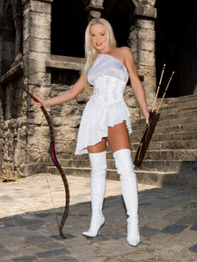 Famous pornstar Silvia Saint poses in white stripper boots in a castle keep