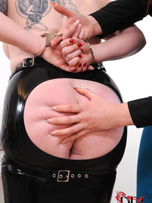 Skirt attired fetish enthusiasts spank and whip bottoms in BDSM scene