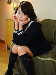 Beautiful Japanese girl Yuri Aine in sailor suit poses to show her pretty face