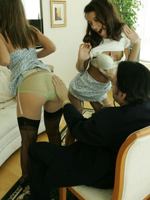 Amateur girls Minnie and Mary tease a man in their underwear and nylons