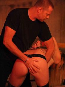 Blonde female undergoes intense BDSM training in a dungeon