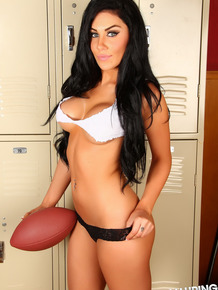 Dark haired chick model in her bra and underwear while holding a football