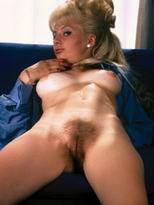 Blonde vintage porn goddess with legs spread showing her horny hairy beaver