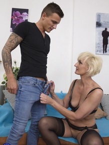 Horny mature proudly shows off her toy boy before fucking him silly