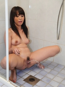Marica Hase toying her hairy cunt and squirting in the shower
