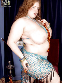 Miss Isabelle performs a belly dance and makes her fat tits and ass bounce