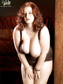 Busty bbw Reyna Mae posing in sheer lingerie and showing her plump ass and tits