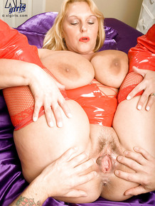 Chubby girl in red latex lingerie gets her boobs squeezed in hardcore fuck scene