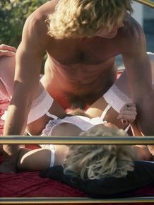 Blonde from the seventies gets banged and jizzed on by 2 men on outdoor bed