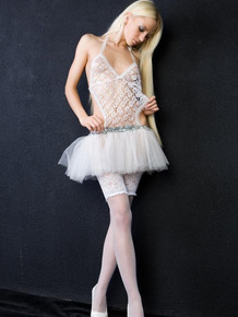 Slim blonde babe Alysha A strips out of her revealing ballerina dress