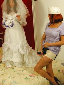 Hot bride Miss Abigail in stockings & high heels enjoys lesbian strapon fuck