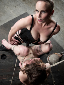 Helpless chick Mercy West is dominated by Bella Rossi during lezdom play
