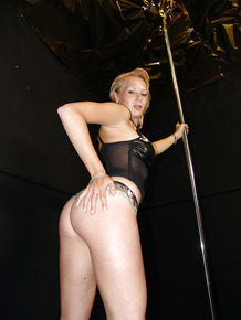 Blonde babe brings on arousing and spectacular striptease show