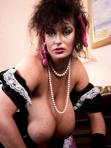 Mature Irish lady Lisa Phillips sets her huge tits free from her maid's outfit