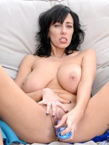 Dark haired lady Alia Janine reveals her natural tits prior to masturbating