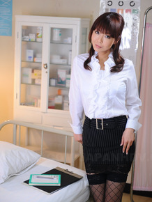 Adorable Japanese girl Kyoushi Kan unbuttons her ruffled blouse in a skirt