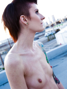 Skinny alt babe with tattooed body exposing tiny tits outdoors on rooftop
