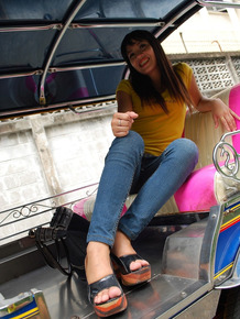 Female Tuk Tuk driver and a Farang ham it up for the camera in a back alley