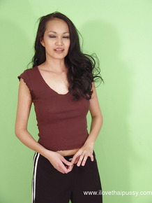 Playful thai seductress with hot curves getting rid of her clothes
