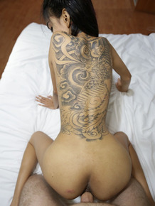 Slender Thai girl with a back tattoo gets banged and filled with cum by Farang