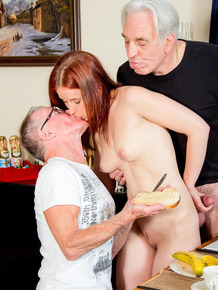Young redhead pleasures 2 really old men at the same time