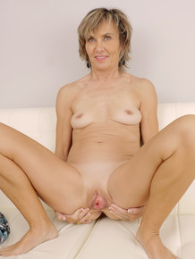30 plus chick Lillian Tesh stretches her pink snatch wide open