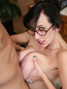 Busty secretary in glasses give titjob & tugs boss's cock for office facial