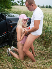Bleach blonde slut gives her man a saggy titjob outdoors on an off road trip