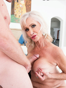 Sexy nan Leah L'Amour pleasures a young man with a BJ and titty fuck