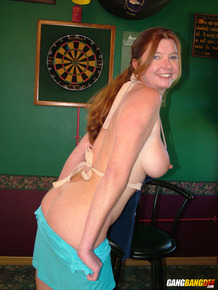Mature lady Dee Delmar goes topless while waiting tables in a pub