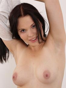 Beautiful brunette hottie Ella Martin peels yoga pants for solo masturbation