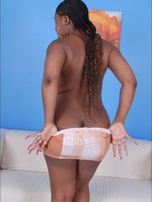 Thick ebony girl uncovers big naturals before finger spreading her snatch