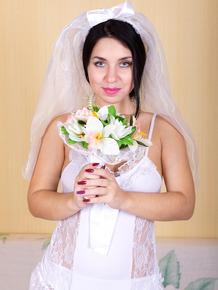30 plus bride Tanita sticks her flower arrangement in her trimmed muff