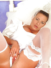 Busty bride Linsey Dawn McKenzie does some rubbing before the wedding.